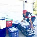 loading boxes of medical and school supplies